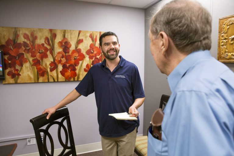 A social worker talking with a client