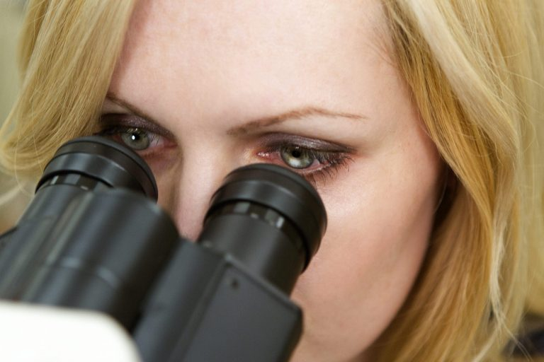 A student using a microscope