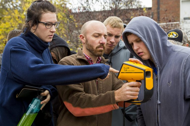 An apprenticeship skilled trades instructor teaching students how to use thermal imaging equipment