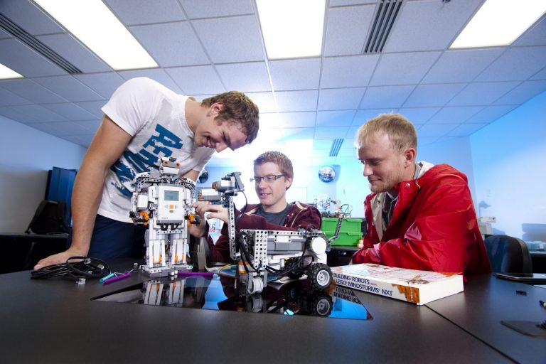 Computer science students building a pair of robots