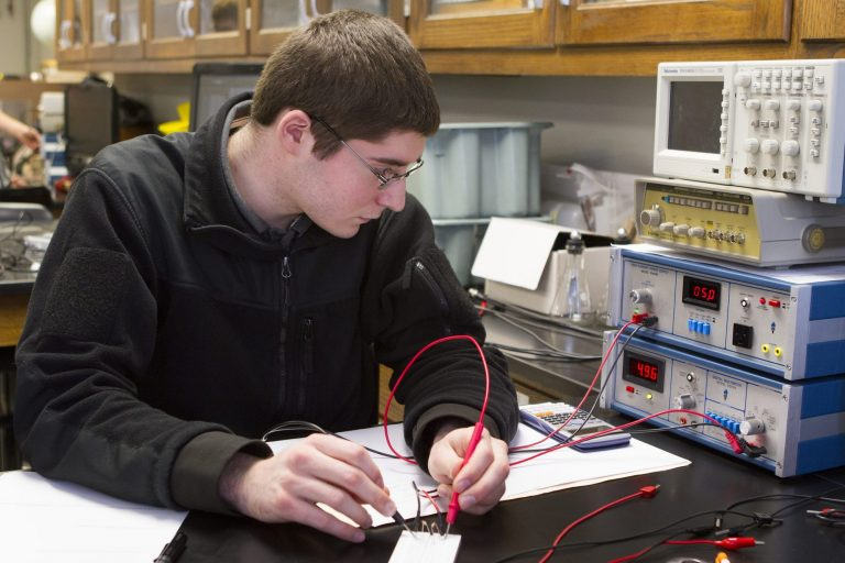 An engineering student working on a wiring project