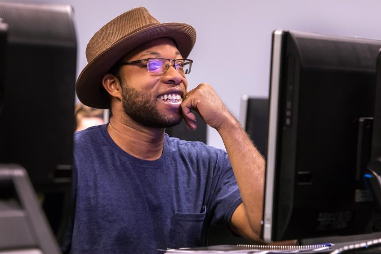 A computer programming student working in a computer lab