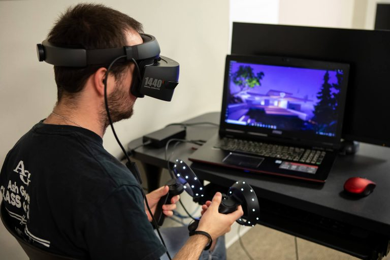 A video game development student testing a virtual reality game