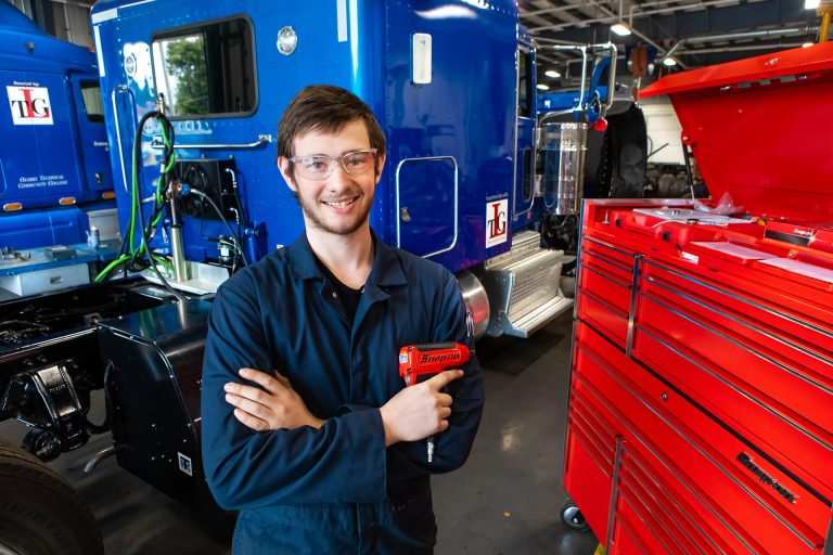 A diesel technology student finding tools in a toolbox