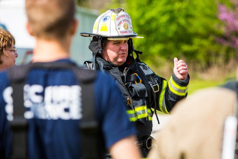 A fire science instructor training his students