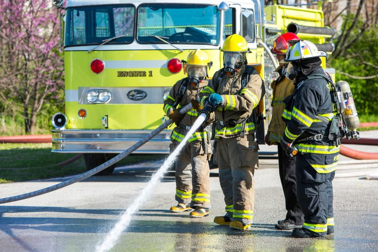 Fire science students learning to use a fire-hose