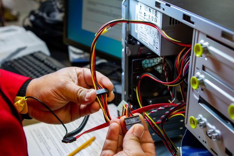 A networking technology student fixing a computer