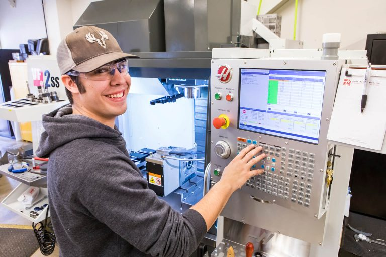 A precision machining student working on a machining interface